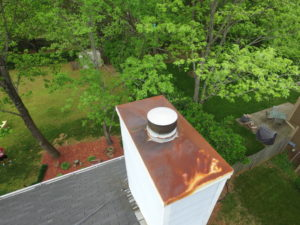 Aerial Drone view of Chimney cap in need of maintenance service.